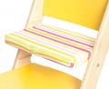 Pruhovaný podsedák na žluté rostoucí židli Sedees
