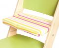 Pruhovaný podsedák na zelené rostoucí židli Sedees