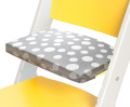 Puntíkatý podsedák na žluté rostoucí židli Sedees
