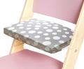 Puntíkatý podsedák na růžové rostoucí židli Sedees