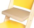 Béžový podsedák na žluté rostoucí židli Sedees