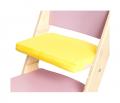 Žlutý podsedák na růžové rostoucí židli Sedees