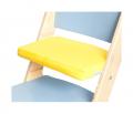 Žlutý podsedák na modré rostoucí židli Sedees