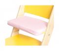 Růžový podsedák na žluté rostoucí židli Sedees