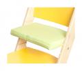 Zelený podsedák na žluté rostoucí židli Sedees